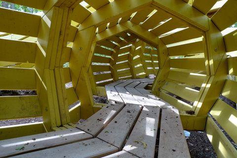 Imaginative Playgrounds by Monstrum \\ Inside the snake there is a long mazy tunnel in which children can hide from both each other and adults. The playground is located in a nature park, and the idea is to provide ways for children to experience nature.