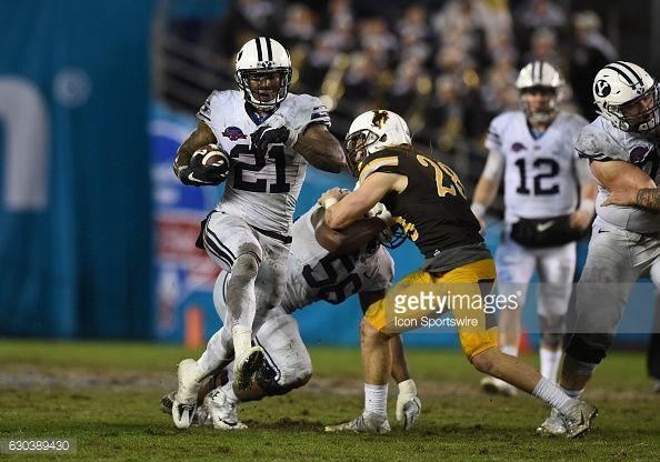 News Photo : BYU Jamaal Williams runs the ball for a touchdown...