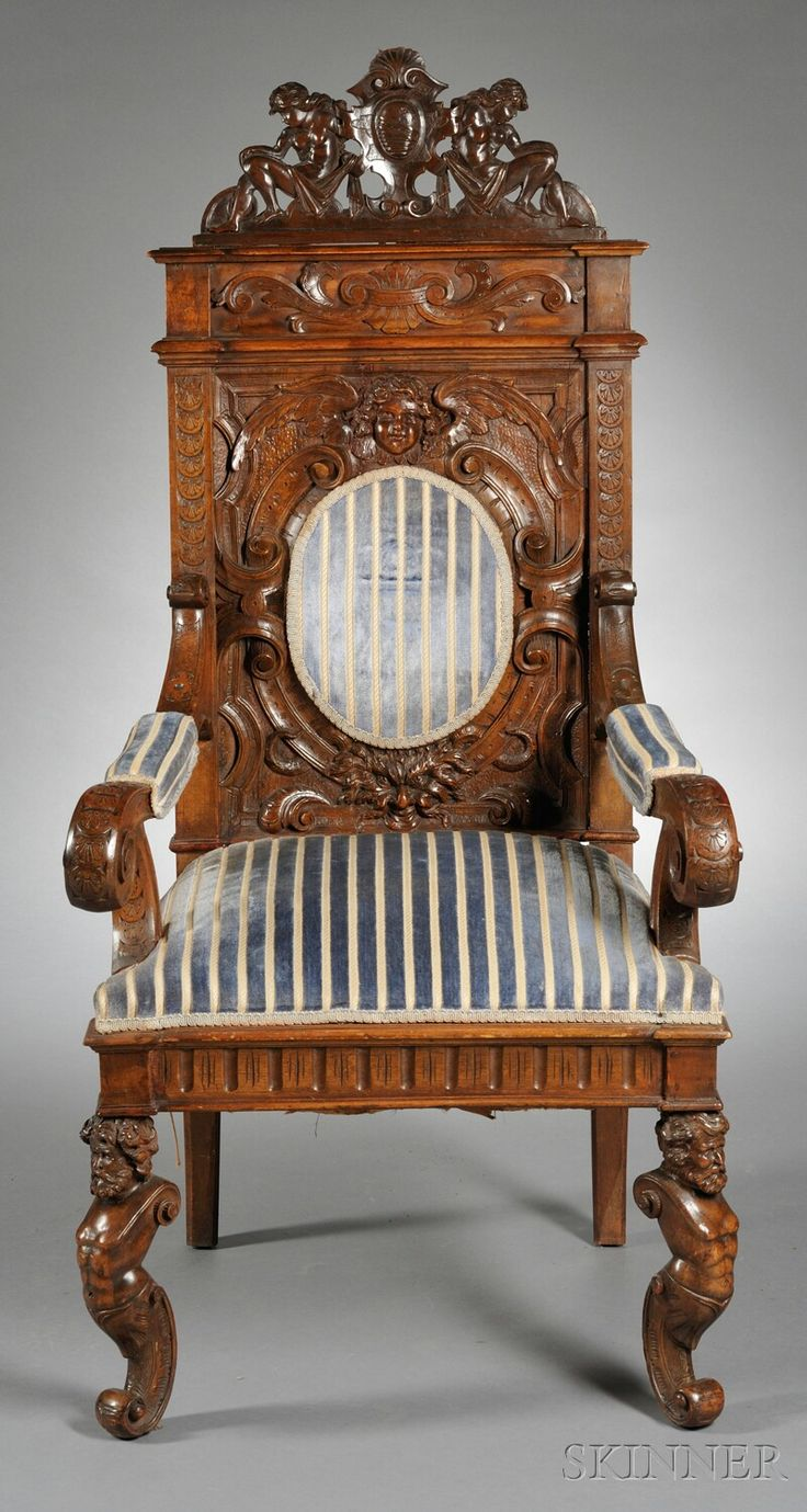 Italian Carved and Upholstered Armchair, with cresting carved as two figures centering a crest, seatback with angel and demon and upholstered oval rest, with scrolled armrests and overupholstered seat, cabriole legs carved with grotesques.