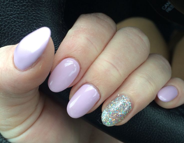 Lavender pale purple pink gel nails. Silver glitter accent nail. Pastel gel nail polish manicure. Almond round shaped nail design