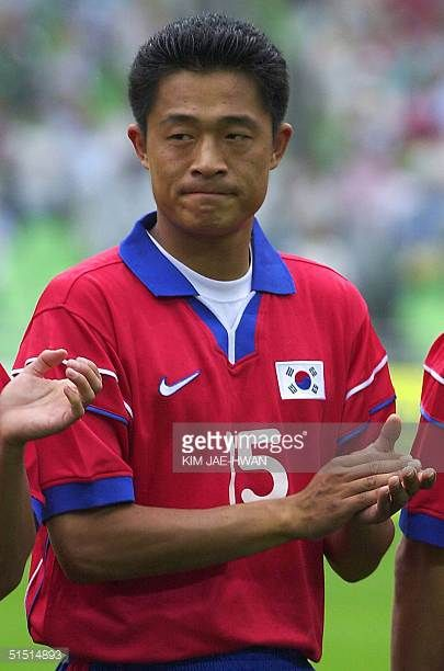 South Korean defender Lee MinSung applauds as he poses with the rest of the team before its opening soccer match against France at FIFA...