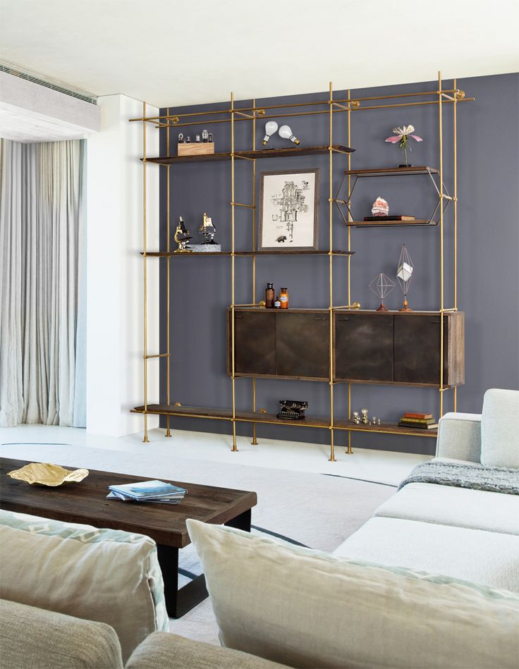 The Collector's Shelving System is fully adjustable and designed to be configured for any space. Shelves and credenza in oxidized oak, frame...
