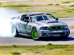 """Vaughn Gittin Jr. will return to Formula Drift this season with a new car, a new livery and a new attitude. Gittin, the 2010 champion, will have a Roush Yates Racing engine in his 2013 Mustang when the series opens its season this weekend on the streets of Long Beach, Calif. """"It's straight out of the NASCAR shop,"""" said Gittin, who has ties to Roush Yates as a Ford Racing driver. """"They've put some magic in this thing. It's a rocket ship."""" The 800-horsepower, 410-cubic-inch V8 should provide…"""