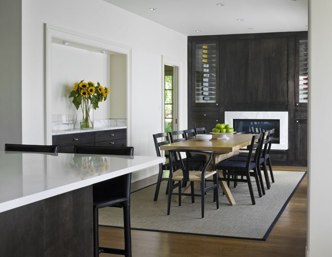 Modern Dining Room With A Touch Of Glamour Black Wegner Wishbone Chairs From Design Within Reach Built In Buffet