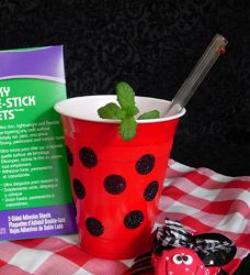 Spotted Ladybug Picnic Cups. Ha! Ha! Ha! Watch out! They bite!  There's an easier way. Just buy black dot stickers, put them on, then dust w/ a little glutter over just a little glue. No need to try & cover all that white area.