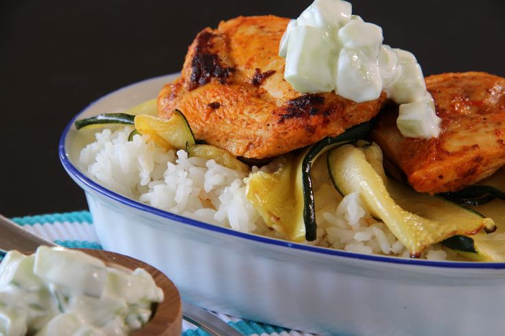 Tandoori Chicken served with Steamed Rice, Cucumber Ribbons and a Yoghurt and Cucumber Rita