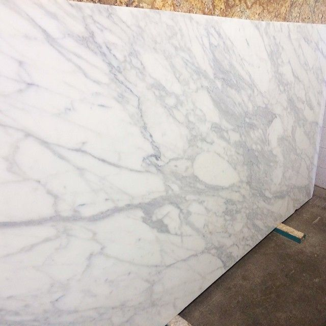 Choosing slabs for the house today... #pinkpeoniesathome Rachel Parcell Calcutta Gold marble kitchen counter