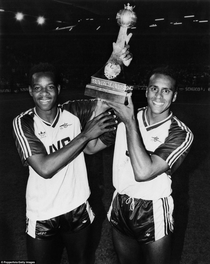 After helping Arsenal to the most dramatic of title wins at Anfield in 1989, Rocastle celebrates with goalscoring hero Michael Thomas