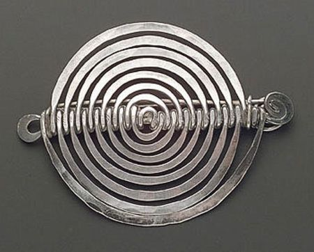 What more could a girl want than tiny, wearable sculpture?  Alexander Calder silver brooch, c. 1942, composed of a single wire planished into spiral and scroll motifs. Sold for $38,775