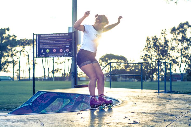 L3M2AP1 ISO250 50mm f/2.8 1/1000th sec Nikon D7100  I was originally trying for silhouettes but I used a radial filter to lighten her instead because of the interference of the sign. This preset has a nice 70s vibe which is perfect for her retro skates. I love the balance and concentration here. and the reflected light around her feet. Frozen moment.
