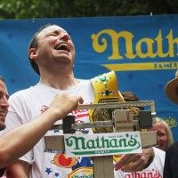 From USAToday: Joey Chestnut eats 69 hot dogs, sets new world record