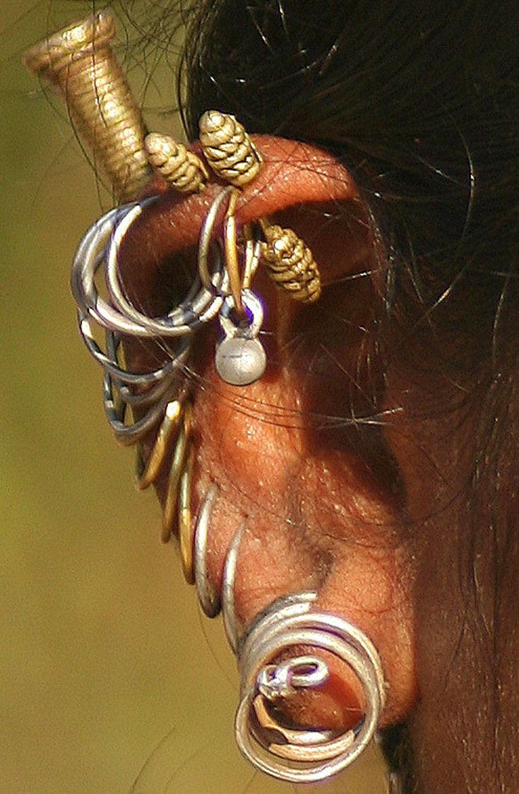India | Details of a woman's earrings in Orissa | ©Rudi Roels