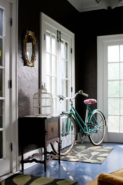 Love the black walls and the bike!
