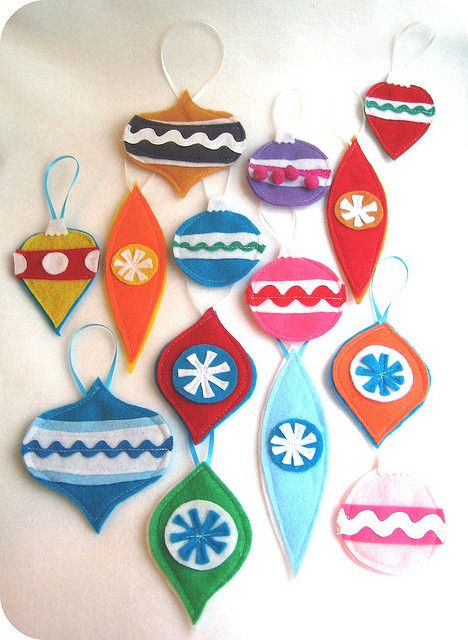 Felt ornaments.  I need retro ideas to do in blue and green, if I want to do retro basement Christmas this year.  I think I need a white tree, too.