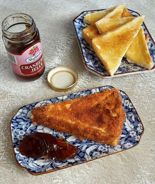 Deep fried brie with cranberry jelly