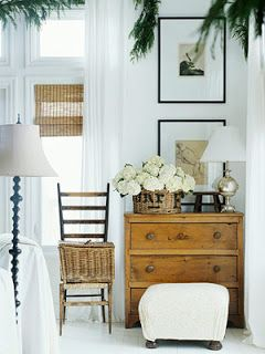 Accessorizing- small vintage chest the color of the blinds, two 16X20 thin black frames with large matts, an open airy chair with a box basket