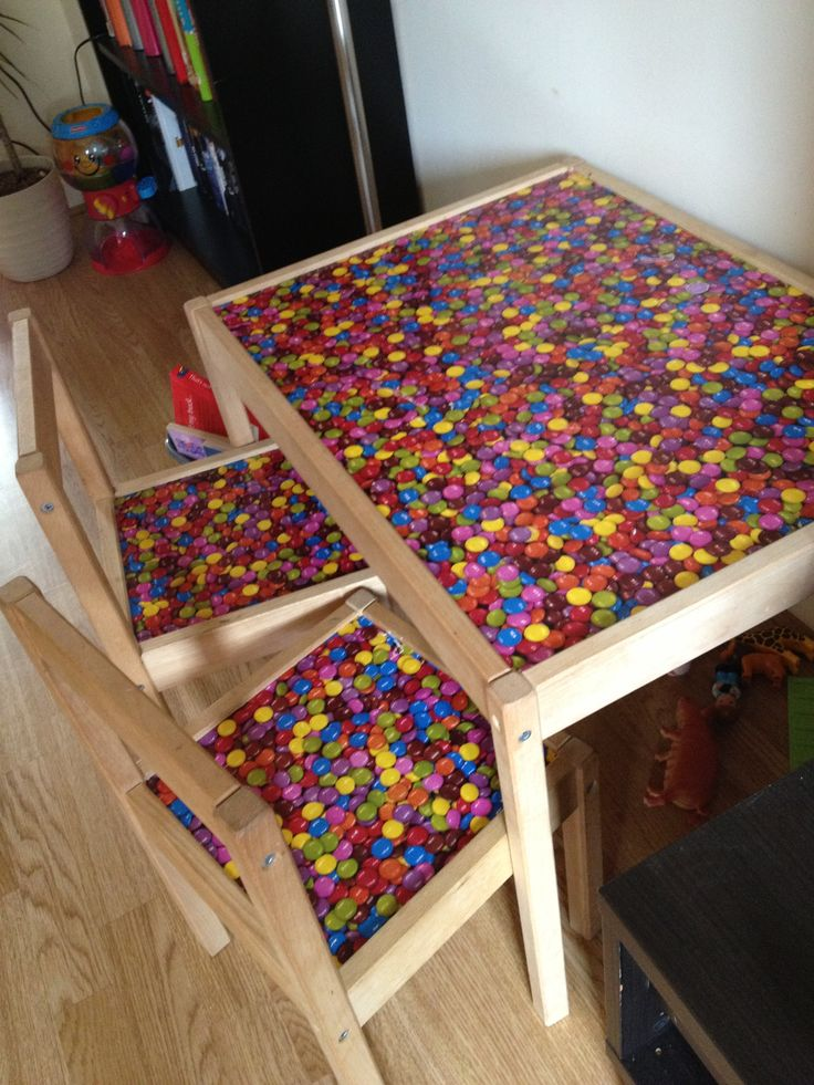 ikea children 39 s table covered in smarties sticky back. Black Bedroom Furniture Sets. Home Design Ideas