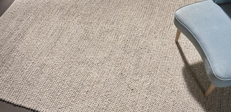 A hand-woven rug with a weaved pattern, made from 100% wool. Available in 2 sizes, in Grey, Ivory or Charcoal.