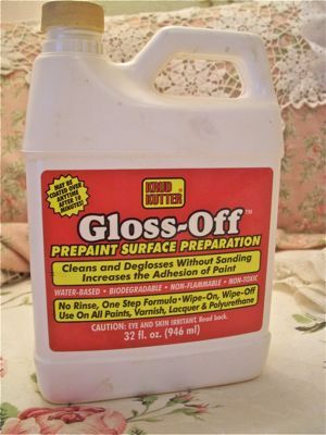 Gloss-Off by Krud Kutter. I found it at Sherwin Williams and the best part is it smells like soap. No strong odor, the store said they use it in schools because it has no odor and is so safe. Not having to sand is especially wonderful when you're painting something with curvy legs or embellishments.