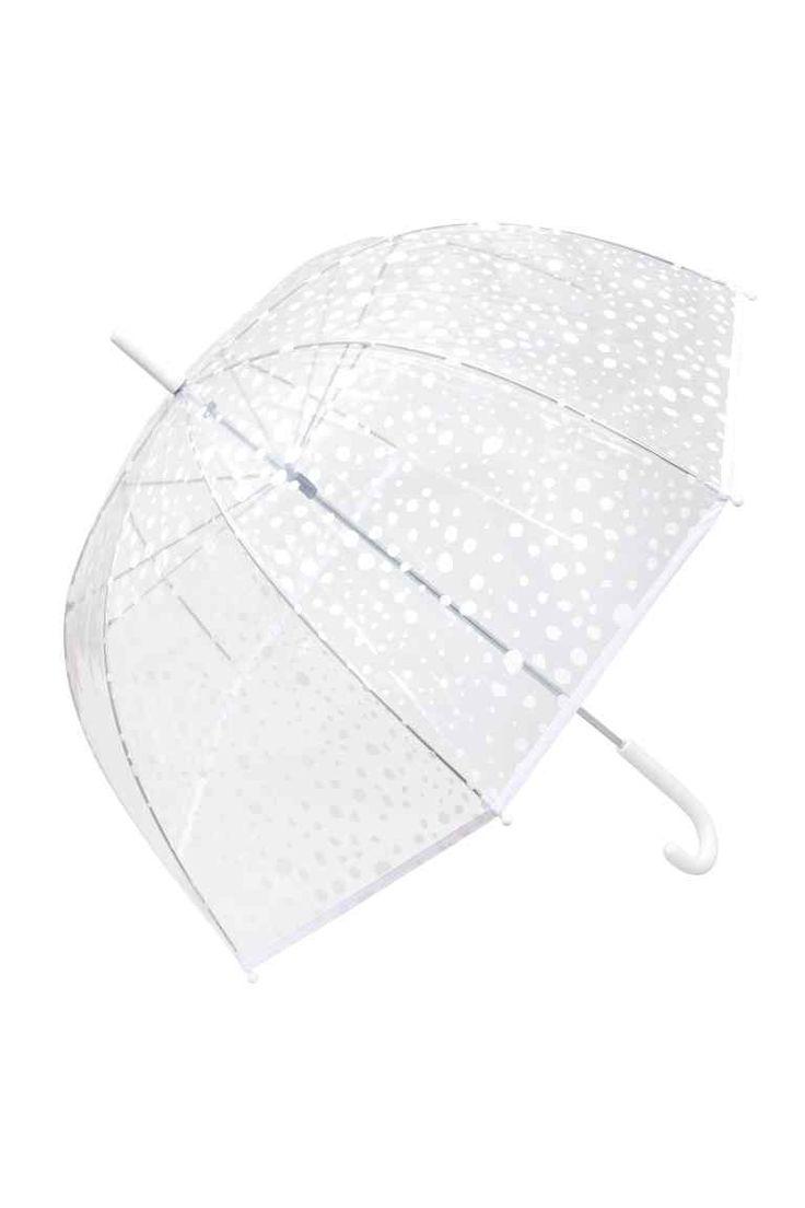 3000 Esernyő: Átlátszó, mintás műanyagból készült esernyő műanyag fogantyúval. Hossza 77 cm.