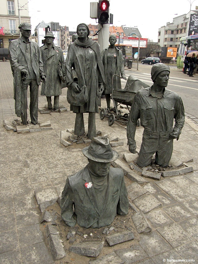The Anonymous Pedestrians Sculpture  in Wroclaw, Poland - art by Jerzy Kalina;  there are 14 statues representing Martial Law in 1981 in Poland, when many people went 'underground' or disappeared in the middle of the night (courtesy of the militia), and later returning ;  photo by bartoszewicz