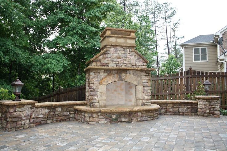 Outdoor Stacked Stone Fireplace With Seating Wall And