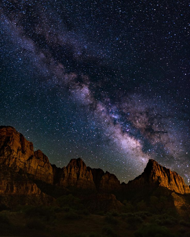 The galactic core over The Watchmen at Zion Utah [4382x5477] [OC] -Please check the website for more pics