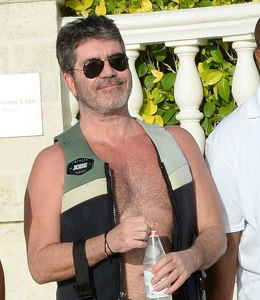 Simon Cowell Hits The Beach In Barbados With Lauren and Eric