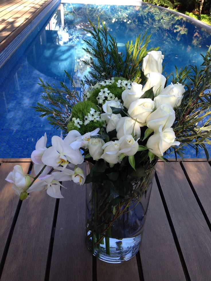 White roses, white phalenopsis, ornitogallum and green flower arrangement for H.stern