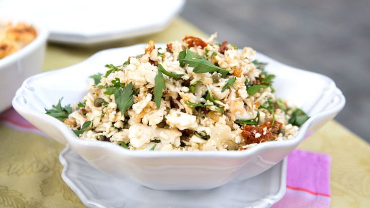 Cauliflower transforms fried rice a light and low-carb meal.