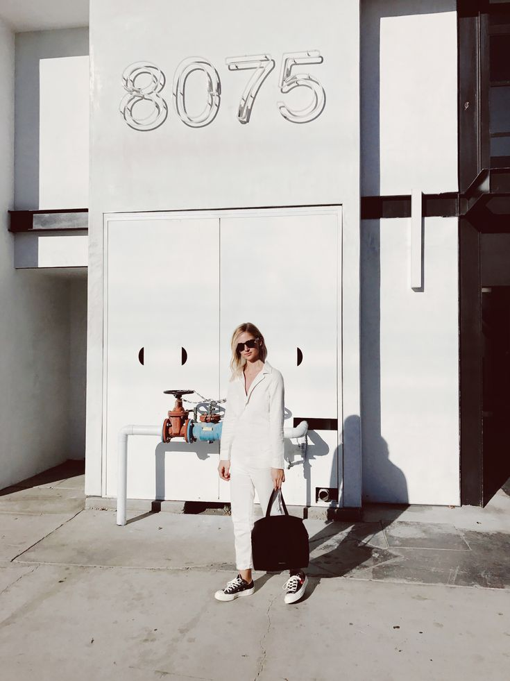 MOTHER       white jumpsuit COMME DES GARCONS PLAY x CONVERSE       heart sneakers (or here) MANSUR GAVRIEL       black suede bag (or here) CÉLINE        sacha shades photography by  F. Flatau  _____   _____ Hanging around Beverly Blvd.   x