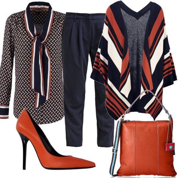 L'arancione è il protagonista di questo outfit. E' presente nella camicia, nel cardigan, nella borsa e persino nelle scarpe. Ad addolcirlo ci pensano la classicità e l'eleganza del blu navy. Perfetto di giorno, ma anche per una serata informale.