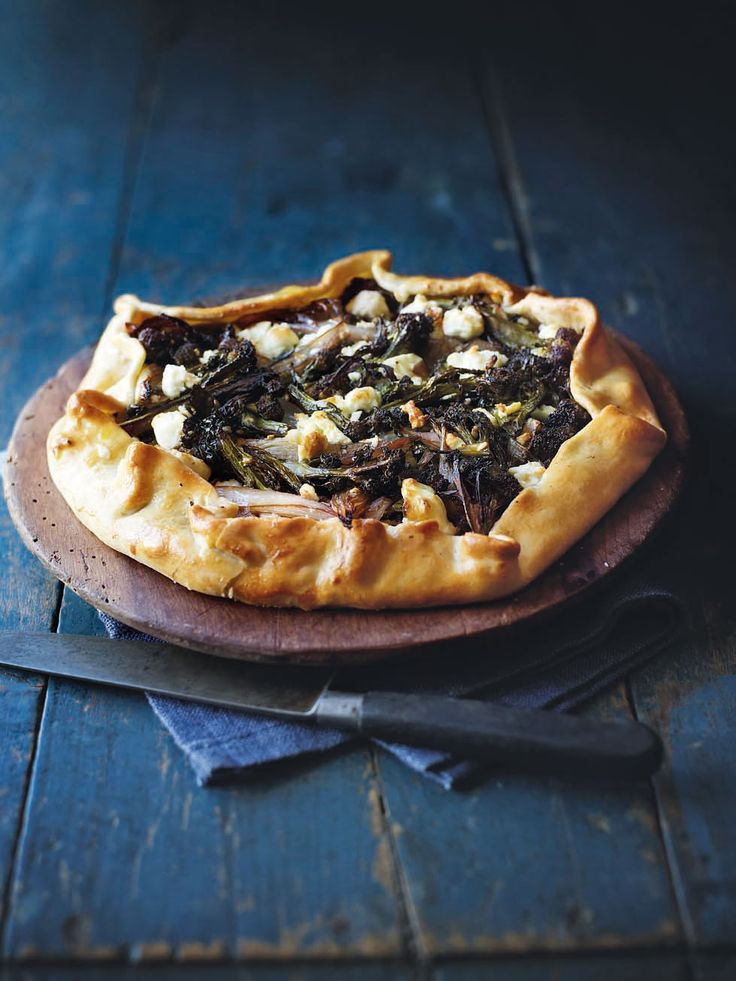 This vegetarian tart is filled with the joys of spring. Sticky caramelised purple sprouting broccoli next to sweet onions and crumbly feta, it's a quick and easy recipe for any night of the week.