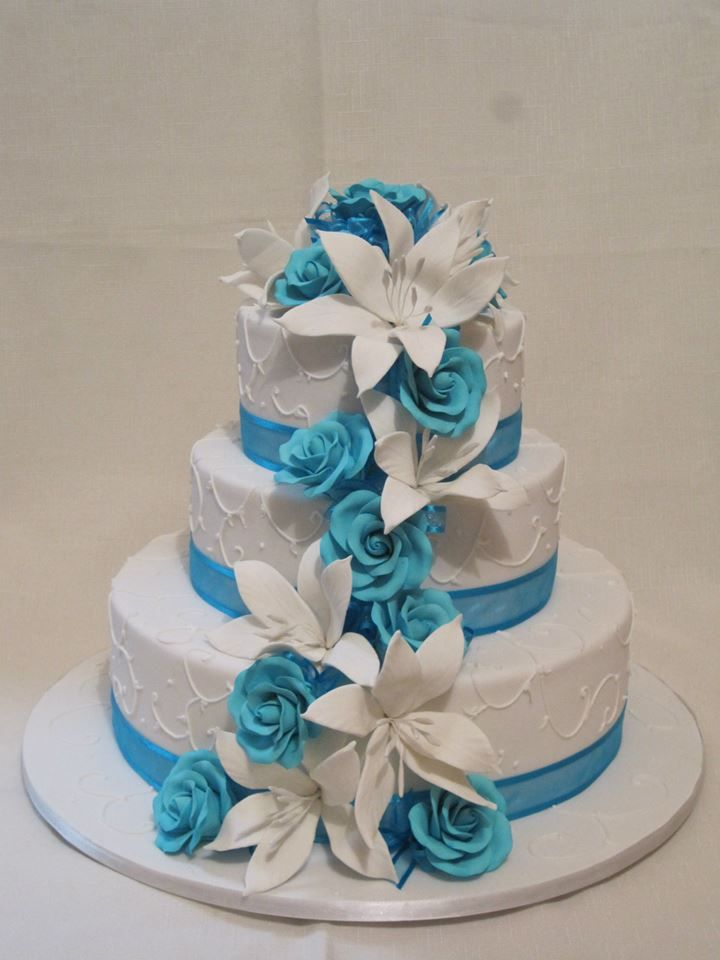 Turquoise and white cascading lilies and roses