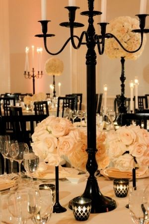 black and white wedding decor. centerpieces. flowers and candles