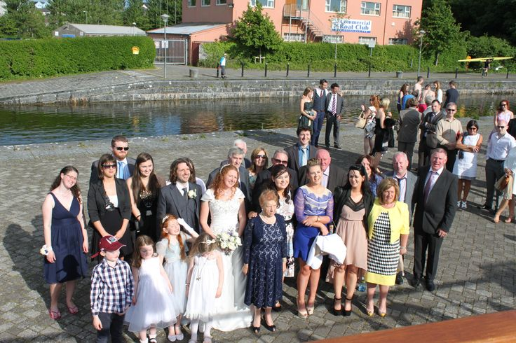 Wedding party gathers on pier