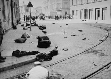A major street in Krakow, strewn with the bundles of deported Jews. During the operation the SS kill approximately 2,000 Jews in the ghetto and transfer another 3,000 Jews. Approximately 2,450 people from this transport are murdered in the gas chamber