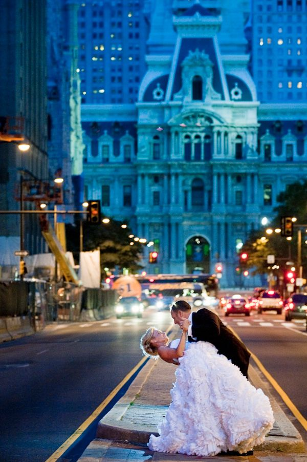 beautiful portrait of bride and groom dancing on street in downtown Philadelphia - photo by New York based wedding photographers Maloman Photographers