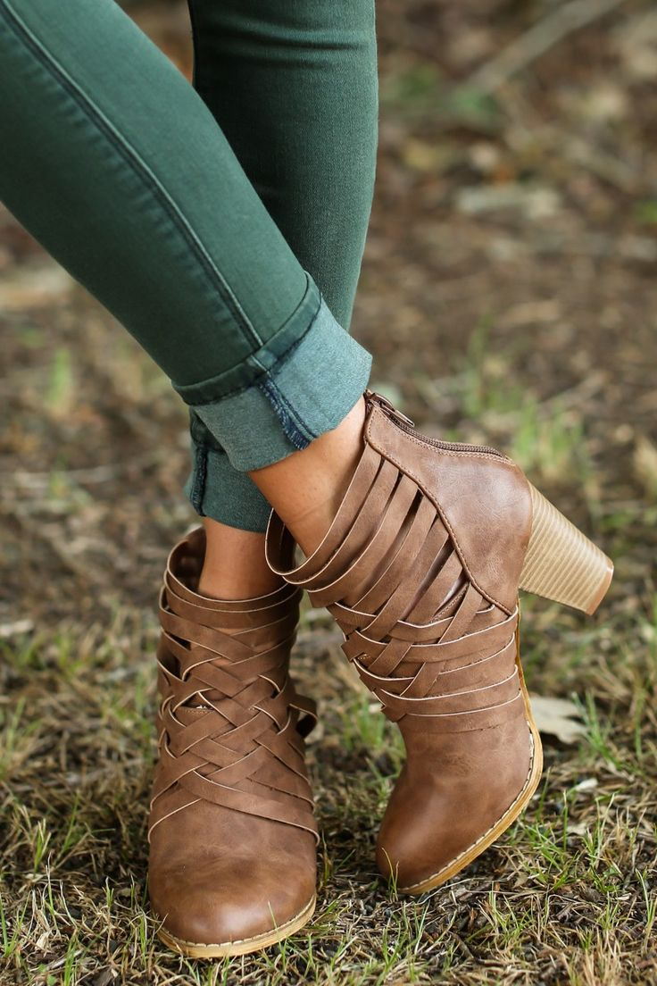 """Pretty, petite, soft, and sympathetic, people often underestimate your strength, but you'll show them you're Strong Enough with these steady Brown Ankle Boots that showcase your tenacity. Your inner strength is stronger than any muscles could support! These booties feature a criss cross upper with a zipper at the heel cup and a stacked heel.  •Heel measures 3.25"""" • Vegan friendly, man made materials •Imported"""