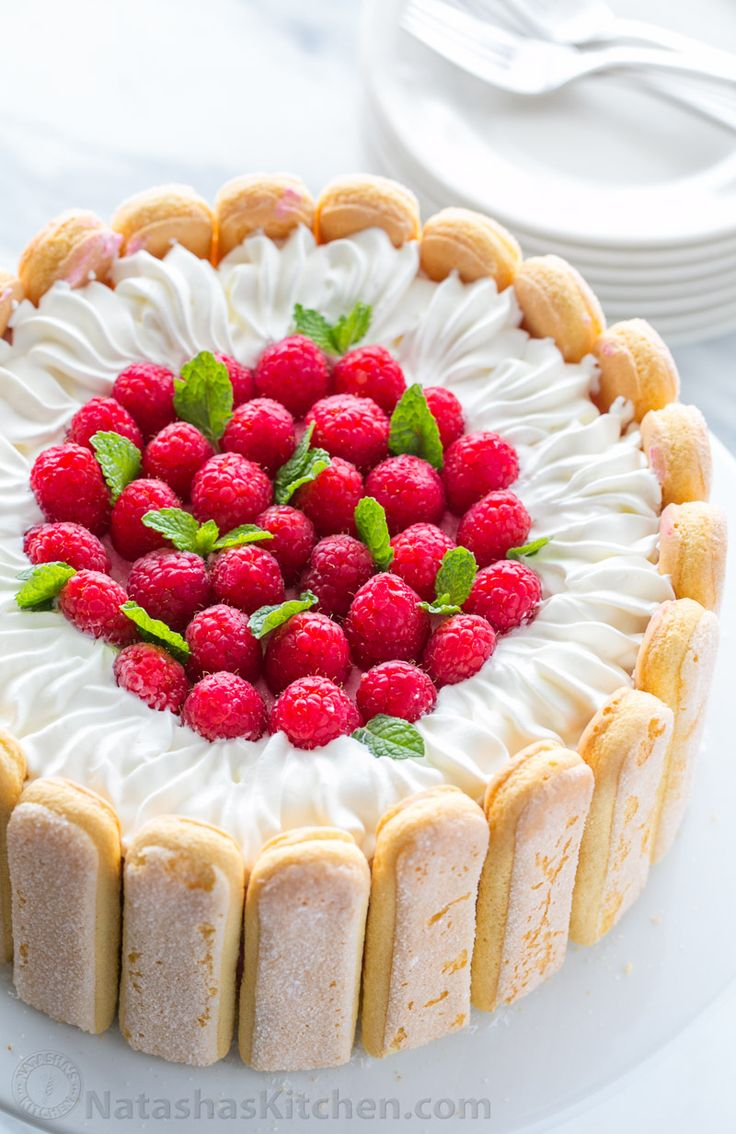 With step-by-step photos, you can master Raspberry Charlotte Cake! A Charlotte Russe Dessert with layers of raspberry mousse, lady fingers and fluffy cake.
