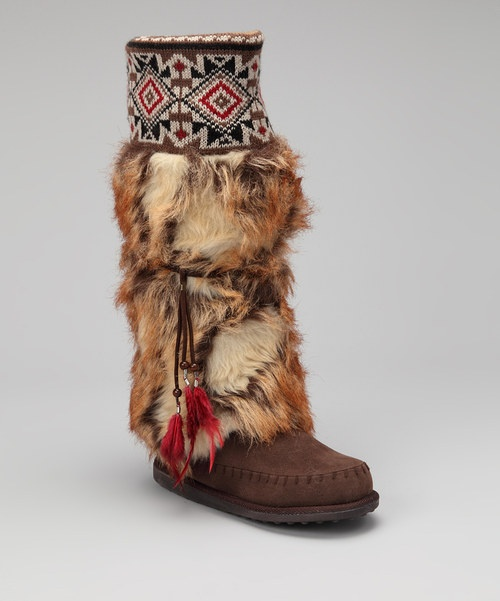 A drop in temperature is a perfect excuse to break out these unique feet treats. With a dazzling knit cuff and fuzzy furry upper, this pair provides a clever look that is part moccasin, part boot. 1'' heel17'' shaft12'' circumferencePull-onFabric / m...