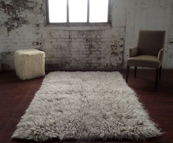 "Stylish 4' x 6' Gray white blend flokati shag rug. Thick and plush 3.25"" shag pile. 100% wool no synthetics! Imported from Greece"