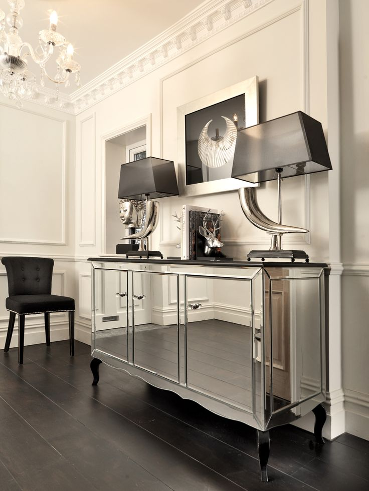 This exquisite mirrored sideboard will add a touch of contemporary elegance and refinement to your home. An exclusive piece of furniture to Black Orchid, finished to a very high standard featuring 3 mirrored cupboards for storage with clear glass ball handles to compliment the grandeur of the piece