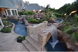 Large Backyard Lazy River Pool Design With Rock And Garden With Lounge ...