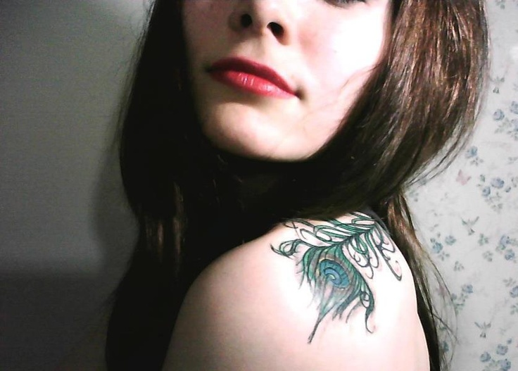 Peacock feather tattoo. Love the placement