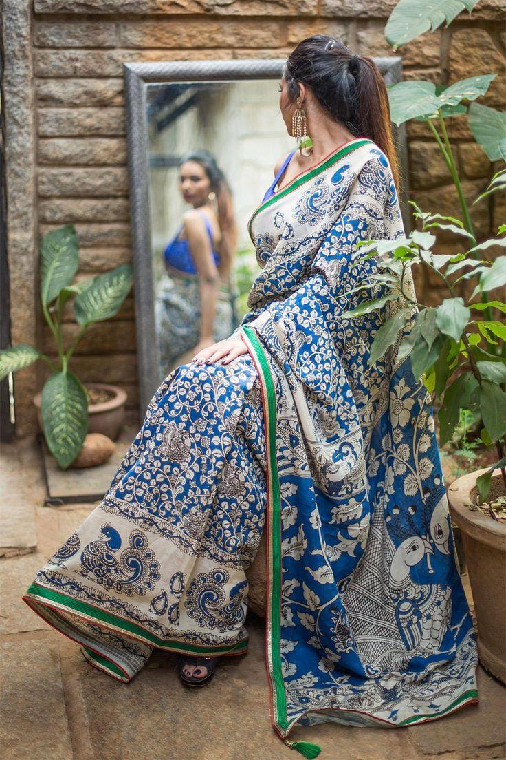 Semi crepe saree with blue and white Kalmakari print & green,red gold border details #saree #houseofblouse #semicrepe #blue #white #kalamkari