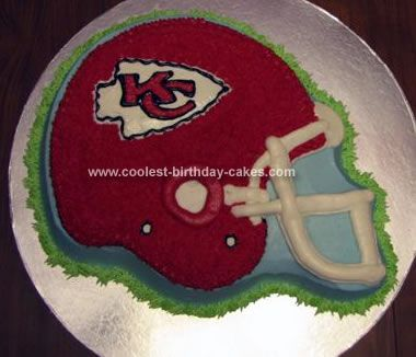 Homemade Chiefs Helmet Cake: I used the Wilton's Football Helmet Pan for this Chiefs Helmet Cake . Flat iced the sides and other areas needed with light blue. Used a grass tip with