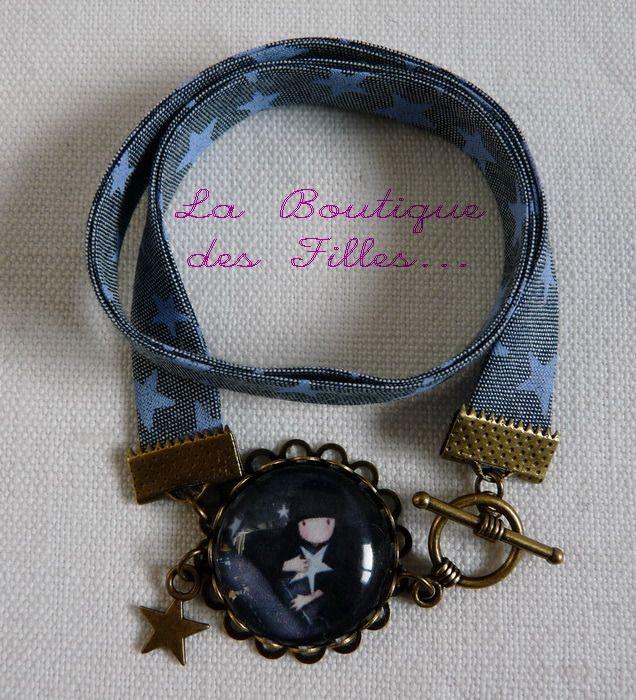 http://www.alittlemarket.com/bracelet/fr_bracelet_2_rangs_biais_etoiles_bleues_avec_cabochon_petite_fille_breloque_etoile_-12502811.html