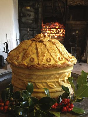 A Christmas Pie with a filling of boned turkey, goose, fowl., duck, partridge and pigeon