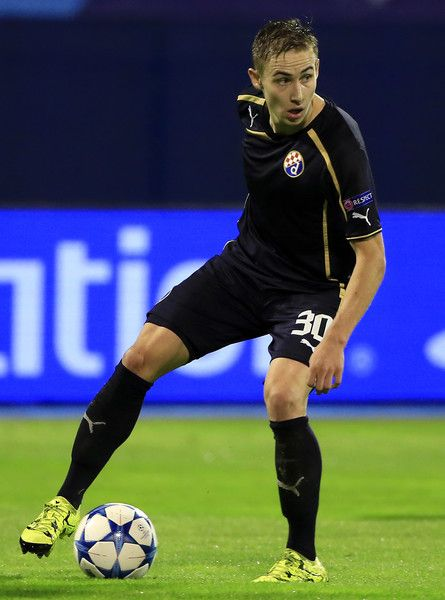 Marko Rog Photos Photos - ZAGREB, CROATIA - AUGUST 25. Marko Rog of Dinamo Zagreb in action during the UEFA Champions League Qualifying Round Play Off Second Leg match between Dinamo Zagreb and FC Skenderbeu at Maksimir stadium on August 25, 2015 in Zagreb, Croatia. - Dinamo Zagreb v KF Skenderbeu - UEFA Champions League: Qualifying Round Play Off Second Leg